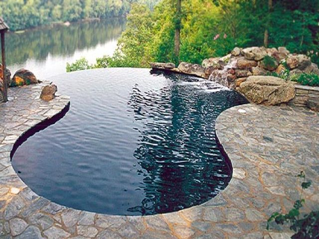 Lesplusbellespiscinesdumonde constructionpiscine for Construction piscine debordement